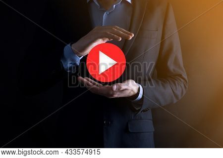 Businessman Pressing, Hold Play Button Sign To Start Or Initiate Projects.video Play Presentation. I