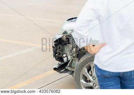 Front Of Car Get Damaged With Young Woman Standing By The Damaged Car After A Car Accident