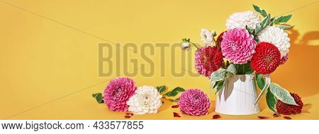 Autumn Dahlias Flowers Bouquet On Yellow Table. Wall Table Background, Banner Format