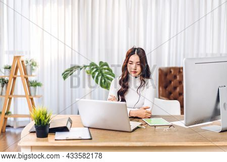 Woman Talk Speak Using Laptop Computer Working And Video Conference Online Meeting With Colleagues A