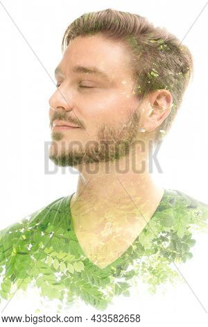 Portrait of a young man with closed eyes combined with a photograph of nature