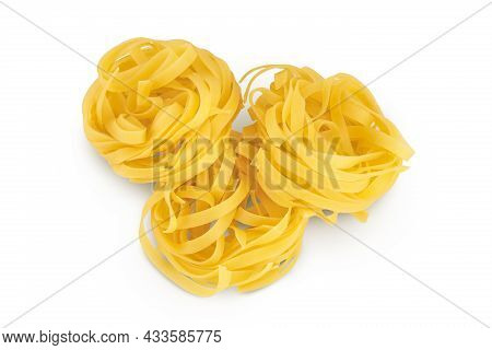 Raw Tagliatelle Pasta Isolated On White Background With Clipping Path And Full Depth Of Field. Top V