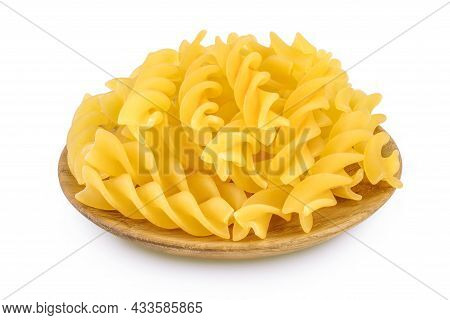 Raw Fusilli Pasta In Wooden Bowl Isolated On White Background With Clipping Path And Full Depth Of F