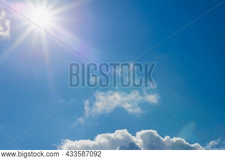 Shining Sun At Clear Blue Sky,clouds.solar Lens Flare. Copy Space.natural Lens Flare.sunrays Of Brig