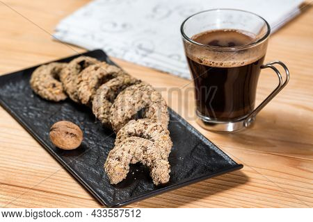 Traditional Walnut Horseshoe Cookies - Orasnice On A Serving Plate With Coffee