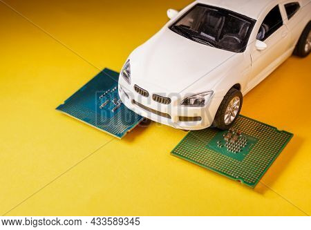 Close Up View Of A White Toy Car On Top Of A Microprocessor . Selective Focus