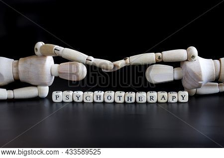 Two Anthropomorphic Puppets Reach Out To Each Other Next To The Inscription Psychotherapy. The Conce