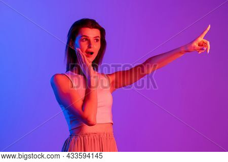 Studio Shot Of Young Caucasian Girl Isolated On Purple, Lilac Color Studio Background. Concept Of Hu