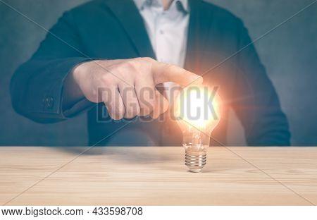 Business Man Point Light Bulbs, Ideas, Innovative Technology And Creativity. Idea Innovation And Ins
