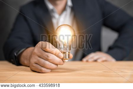 Man Holding Light Bulbs, Ideas Of New Ideas With Innovative Technology And Creativity. Concept Creat