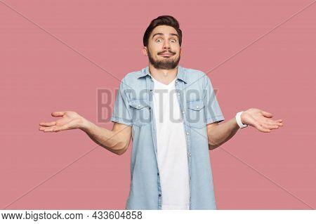I Dont Know. Portrait Of Confused Handsome Bearded Young Man In Blue Casual Style Shirt Standing Wit