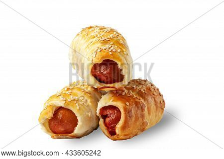 Sausage In Dough. Sausage Roll Isolated Over White Background.