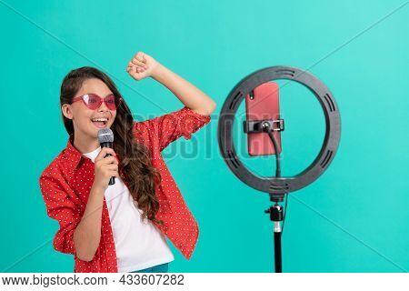Happy Teen Girl Singer Blogging Online With Selfie Led And Microphone, Karaoke Online.