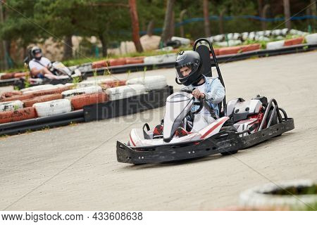 Karting. motorsport road racing with open-wheel four wheeled vehicles at go-karts