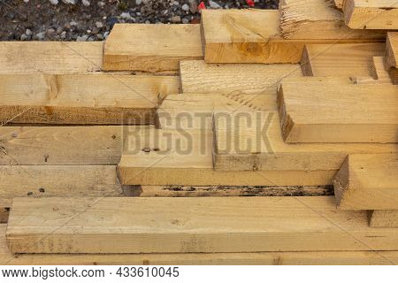 Stacked Lumber. Folded Wood.closeup Wooden Boards.the Surface Of The End Of The Board.lots Of Planks