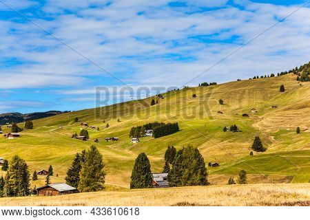 Alpine shepherd's hut. Alpe di Siusi is charming plateau in the Dolomites, Italy. Beautiful sunny day for hiking and taking photos. The concept of walking, ecological and photo tourism