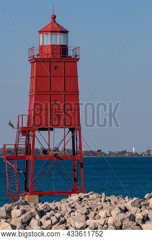 A Red Breakwater Lighthouse Along Lake Michigan.