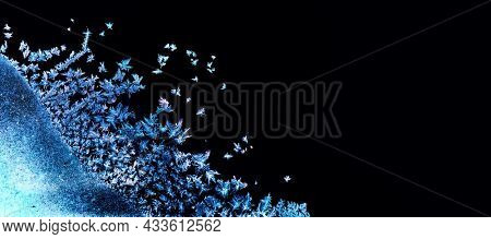 Frozen winter window. Window frozen glass, ice crystals. Snow frame. Beautiful Hoarfrost pattern, rime on black background. Christmas or New Year backdrop for screen mode use.
