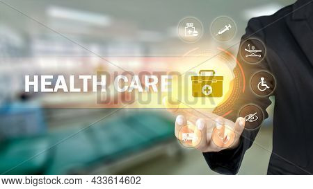 Businessman Holding Icons With Medical Symbols On Blurry Background, Health Insurance Concept. Healt