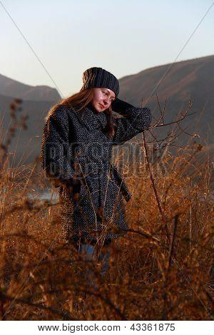 Girl In Bushes