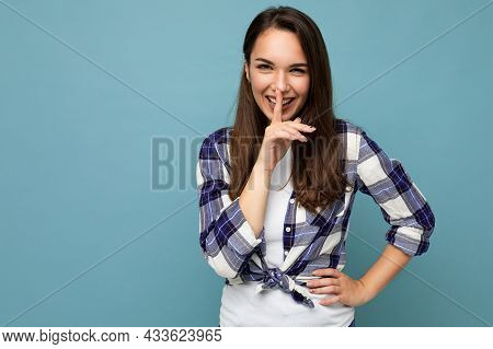 Young Positive Smiling Beautiful Brunet Woman With Sincere Emotions Wearing Trendy Check Shirt Stand