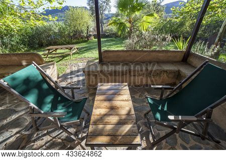 Porch Country House With Folding Canvas Deckchairs. Rural Tourism Concept