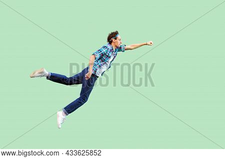 Superman Flying. Enthusiasm Concept. Full Length Profile Side View Of Young Man In Casual Style Felt