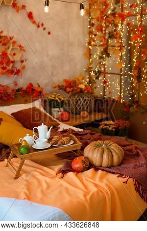 Autumn Bedroom, Living Room Interior. Wooden Tray With Breakfast On Bed With Fall Background.