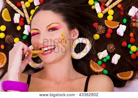 Beautiful girl with sweets and candies