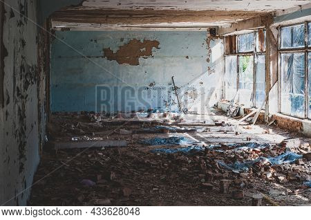 Old Non-residential Building From Inside, Peeling Paint And Fallen Plaster With Various Construction