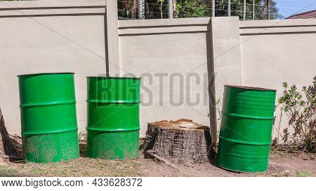 Three Green Steel Metal Forty Five Gallon Or Two Hundred Liter Bins Or Barrels Used For Garden Refus