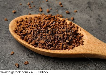 Spoon Of Chicory Granules On Grey Table, Closeup