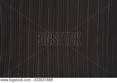 Black Pleated Fabric. Plisse Fabric Background Texture. The Texture Of The Black Pleated Fabric. Bla