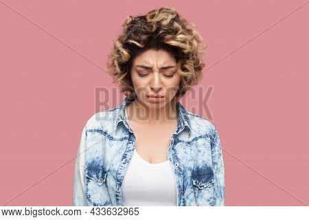 Portrait Of Depressed Sad Alone Young Woman With Curly Hairstyle In Casual Blue Shirt Standing, Clos