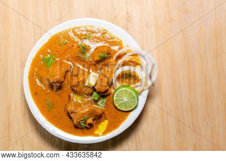 Indian Famous Non Vegetarian Curry Dish Butter Chicken Also Known As Murgh Makhani In White Plate Wi