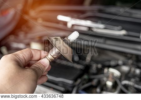 Close Up Hand Car Mechanic Man Hold Oxygen Sensor Exhaust System Of Gasoline Engine Checking For Fau