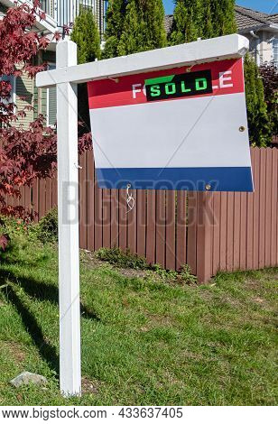 Real Estate Sold And House For Sale Sign On The Post