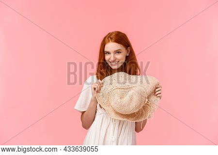 Coquettish Girl Seducing Someone With Affectionate Daring Gaze, Playfully Holding Straw Hat, Look Fr