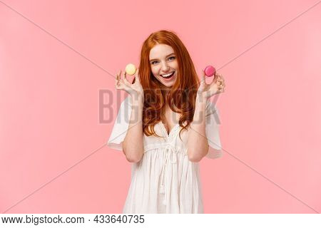 Girl Inviting Sit With Her Enjoy Tea With Desserts. Stunning, Alluring Redhead Female In White Dress