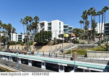 REDONDO BEACH, CALIFORNIA - 15 SEPT 2021: The International Boardwalk and Village Condos at the Redondo Beach Pier.