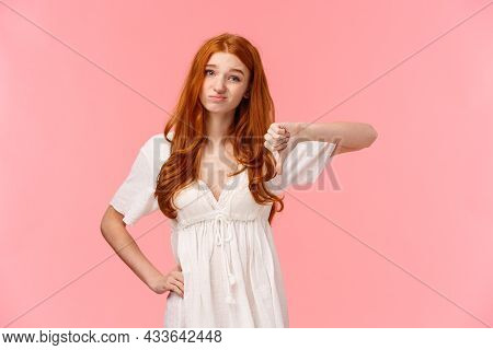 Skeptical And Judgemental Cute Redhead Girlfriend Expressing Her Negative Opinion, Squinting And Gri
