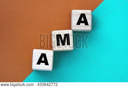 Ama - Acronym On Wooden Cubes On A Multi-colored Background. Info Concept