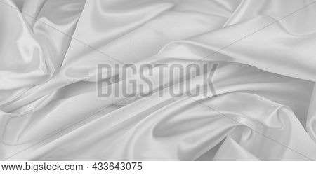 Close-up of rippled white silk fabric lines