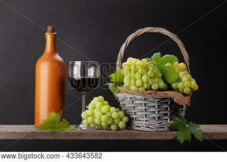 White grape, wine bottle and red wine glass