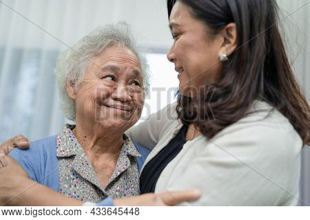 Asian Elderly Woman With Caregiver Walking With Happy.