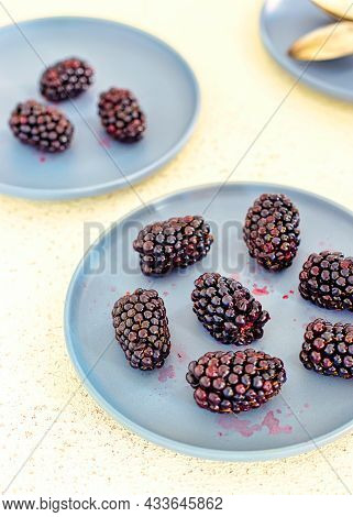 Fresh Blackberries On A Blue Plate Ready To Eat