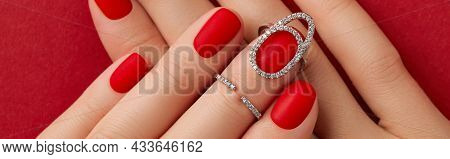 Close Up Womans Hands With Matt Nails On Red Background. Manicure, Pedicure Design Trends