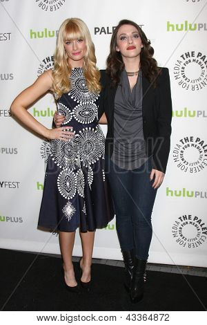 """LOS ANGELES - MAR 14:  Beth Behrs, Kat Dennings arrives at the  """"2 Broke Girls"""" PaleyFEST Event at the Saban Theater on March 14, 2013 in Los Angeles, CA"""