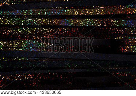 Colorful Glowing Rainbow Drops And Lights On Black Lined Background. Abstract Holographic Backdrop.