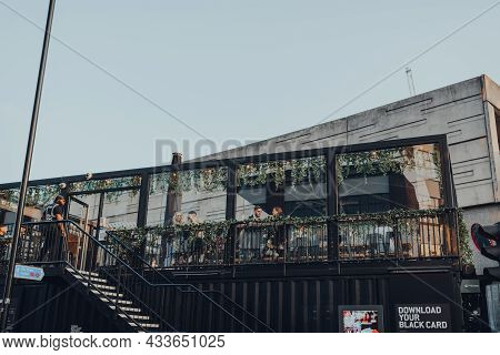 London, Uk - September 03, 2021: View From The Street Of People At The Roof Cafe At Boxpark Shoredit